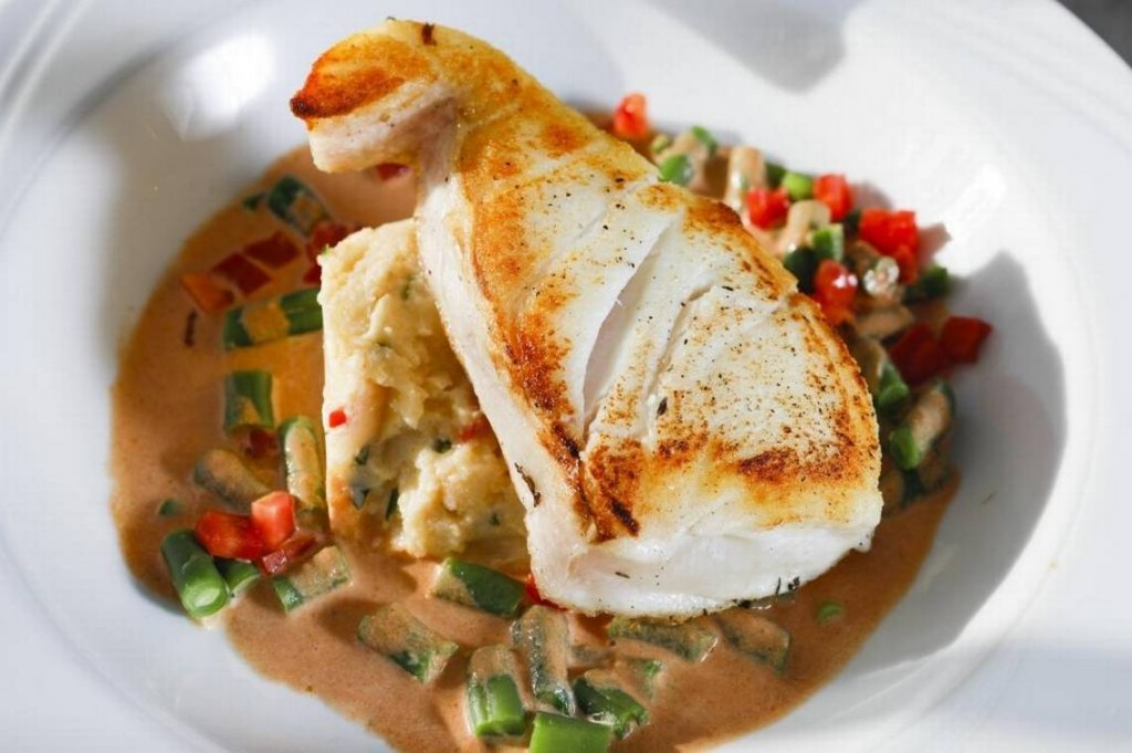 Alaskan halibut is served with herbed polenta and lobster sauce at Blue Moon Over Avila in Avila Beach. David Middlecamp dmiddlecamp@thetribunenews.com
