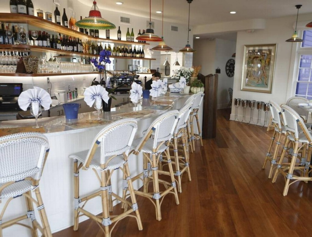 Blue Moon Over Avila in Avila Beach features soft nautical colors and high-end finishes such as marble tabletops, rattan chairs and colorful lighting fixtures. David Middlecamp dmiddlecamp@thetribunenews.com