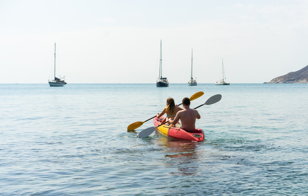 Couple on kayak on the beautiful bay . Back view